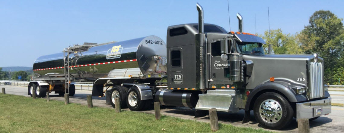 bulk liquid tanker carriers delivering chemical freight on grass