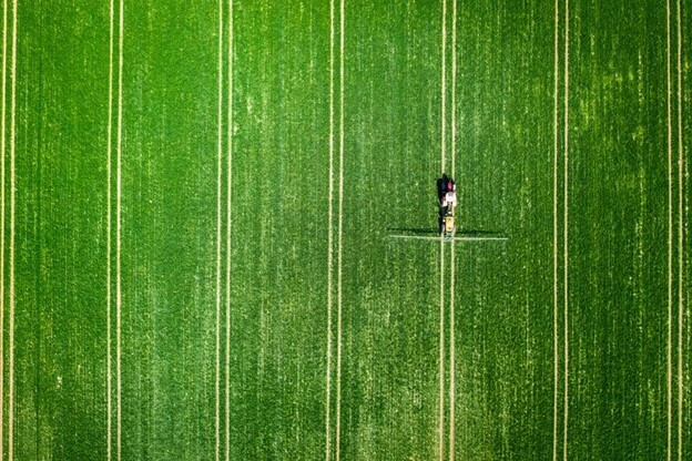 Aerial view of fertilizer spreading on a field.
