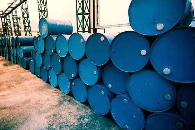oilfield drums stacked and filled with drilling fluids.